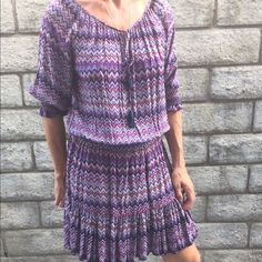 Fun and fabulous NWOT dress by Eight Sixty This is a totally fun and fabulous dress. It is made of 100% rayon and is a size medium. The colors are blue purple magenta black and gray. The front has a small tie opening with a tassel. Eight Sixty Dresses