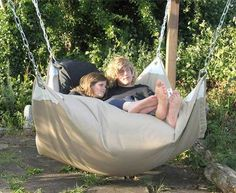 Build a backyard pergola and then hang a beanbag-hammock hybrid swing chair.
