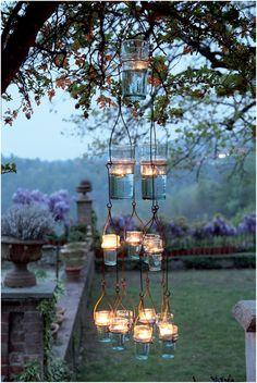 Illuminez jardin et balcon avec un photophore original. http://www.amenager-ma-maison.com/photophore-a-suspendre-en-fer-4-niveaux-PR-861.html