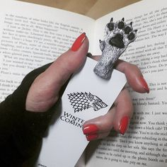 Quirky Bookmarks Look Like Tiny Legs of Literary Characters Sticking Out Between Pages - My Modern Met