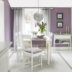 ...Color more looks like Exclusive plum by SW- in any case is sophisticated and elegant paired together with white furniture and accents...