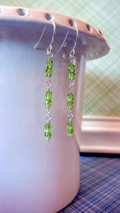 Two by Two hand strung peridot green Czech glass beads on silver plated wire with silver plated french style earwires