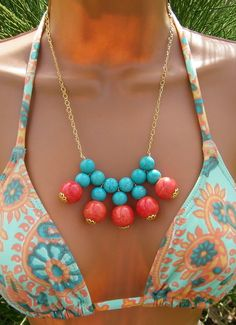 Stone Turquoise bib necklace with orange ceramic beads.  Get your DIY jewelry supplies at www.fizzypops.com. Make one for yourself!
