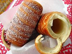 Kürtőskalács - a Hungarian pastry also known as chimney cake or stove cake. It is baked on a tapered cylindrical spit over an open fire. In the past decades, it became popular to bake it in special gas- and electric ovens. #Budapest #Hungary #gastronomy