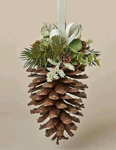 Natural Pine Cone Hanger with Faux Pine, Eucalyputs, Meadow Grass and Ivory Bow Christmas Pine Cones, Irish Christmas, Noel Christmas, Homemade Christmas, Rustic Christmas, Pinecone Ornaments, Diy Christmas Ornaments, Christmas Wreaths, Christmas Decorations