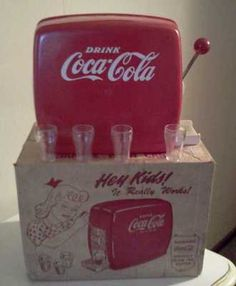 1950's & Early 1960's Toy Coke Machine. I wanted one of these for Christmas when I was a little girl in the 60s.  I got a Pepsi one instead.  I still had fun playing with it.  Don't know why, but I've always had a fascination with Coca-Cola stuff.