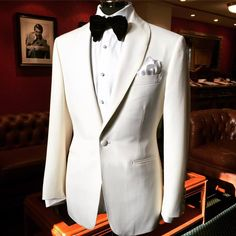 Single breasted, one button with wide shawl lapel. Covered buttons to match. Oversize velvet bow tie all by cloth by White Wedding Suit, Wedding Men, Wedding Suits, Dinner Jacket, White Suits, Mens Fashion Suits, Men's Fashion, Groom Attire, Suit And Tie
