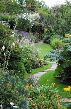 Garden path with mixed border. The Mill Garden, Warwick Castle.
