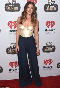 Golden girl: Just hours later, Minka had not only changed states but outfits as she dazzle...