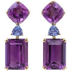 Amethyst and Tanzanite Ear Clips - Beautifully crafted faceted emerald-cut and cushion-cut Amethyst of top quality, bright color are highlighted by a brilliant medium blue Tanzanite transition stone. 4 Amethysts weigh a total of over 52 carats with 2 Tanzanites weighing a total of 2.75 carats. Set in 18 karat yellow Gold. Signed DV. •$8,500.00