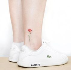 Single rose tattoo on ankle by Heejae Jung
