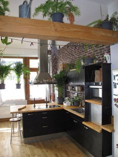 Black and wood kitchen, brick wall Atypical Spaces – Old shop near Luxembourg gardens for sale paris (Oct Source by macaronaddict House Design, Cozy Kitchen, Industrial Style Kitchen, Brick Kitchen, Home, Interior Design Kitchen, Home Kitchens, Grey Kitchen Walls, Kitchen Design
