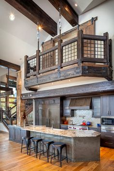 Sensationally rustic kitchens in mountain homes Rustic Kitchen and Railing - I like the pocket doors on the loft. Limits noise from traveling up.Rustic Kitchen and Railing - I like the pocket doors on the loft. Limits noise from traveling up. Metal Building Homes, Metal Homes, Building A House, Building Ideas, Building Design, Morton Building Homes, Rustic Kitchen Design, Rustic Kitchens, Rustic Homes