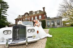 Bride and groom with this oldie limo. Very vintage. beautiful background.