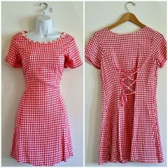 """$24 - Vintage 90s Grunge Daisies Dress - Size Petite XS - Adorable 90s grunge piece! Pink and white checked pattern. Fit and flare shape. Crochet daisies at neckline. Lace-up detail in back. Great mini length. Bust - 35"""" Waist - 32"""" (can be cinched to fit smaller) Hip - 50"""" Length (shoulder to hem) - 32"""" Size - Vintage girls' 14 1/2; estimated petite XS (PLEASE CHECK MEASUREMENTS) Label - Swat Materials - acetate, rayon Color may vary slightly based on screen display. #90sstyle…"""