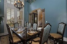 Traditional Dining Room with Chandelier, High ceiling, Columns, Hardwood floors