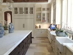 Elegant huge island in blue and white French inspired Enchanted Home kitchen