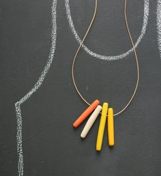 Necklace / notTuesday Looks like it's made from Fimo, rolled into cylinders then skewered through the top.