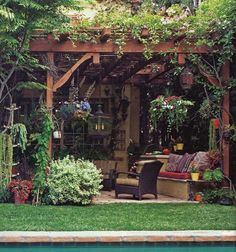 SWOON!! Overgrown pergola (with strings of lights!) over outdoor dining area/hangout