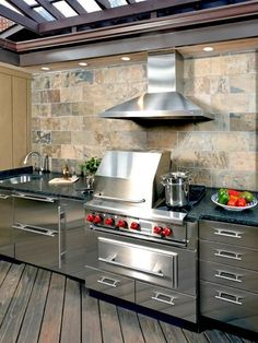 Beautiful Kitchens and Dining Rooms * Stainless facade cabinets and island with wood countertops, exposed brick and a fabulous mix of tile and wood floors.