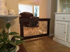 Low enough to step over swings open on hinges just in case. Its a simple wood frame built around an iron wall hanging from Hobby Lobby. Baby Gates, Dog Gates, Pet Steps, Pet Gate, Dog Rooms, Iron Wall, Mellow Yellow, Decoration, Home Projects