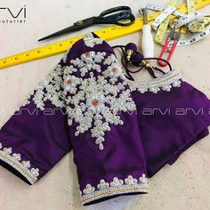 Gorgeous purple color designer blouse with creeper and floral design hand embroidery work on neckline and sleeves. Pattu Saree Blouse Designs, Fancy Blouse Designs, Bridal Blouse Designs, Blouse Back Neck Designs, Stylish Blouse Design, Designer Blouse Patterns, Work Blouse, Bridal Lehenga, Bridal Gown