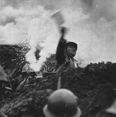 This excellent combat photo captures a Japanese army soldier throwing a lit stick of dynamite in the direction of Chinese soldiers, somewhere along the great wall, northern China, 1937.