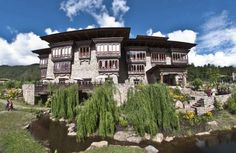 Zhiwa Ling Hotel | National Geographic Unique Lodges of the World | Paro, Bhutan  The first five-star Bhutanese-owned hotel, Zhiwa Ling, is an architectural gem that unites Bhutanese culture and heritage with 21st-century comforts. Guests can join monks at the Meditation House and enjoy a unique selection of spa treatments imbued with spiritual symbolism.