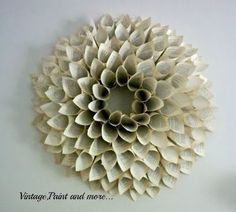 Book Page Wreath Tutorial - large book page wreath (I want to do this with a little poof of burlap in the center and a little bunch of flowers nestled within that)