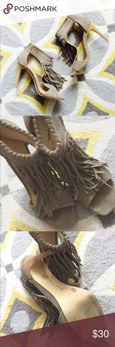 Fringe Heels!! Gorgeous!!! Fringe Heels!! Gorgeous!!! These heels were worn twice! They are in like new condition! These heels are absolutely gorgeous and comfortable to wear. The heel is approximately 4 inches. They are Leather and zip up in the back for easy on/off. Ask me any questions! Chinese Laundry Shoes Heels
