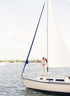 Photography: Melanie Gabrielle - melaniegabrielle.com  Read More: http://www.stylemepretty.com/2014/09/15/sailboat-engagement-session-in-miami/