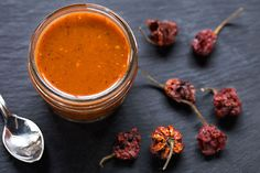 This hot sauce gets a bright blast of searing heat from dried Carolina Reaper Chiles, the hottest chiles on record according to the Guinness Book of World Records. Use it very carefully and sparingly, like you would any other hot sauce. We recommend adding a few drops to a strong Bloody Mary or stirring a splash into cocktail sauce for dipping shrimp or poached lobster.