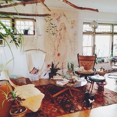 Love the limbs suspended from the ceiling....thinking this will work great in my Sunroom!!   bohemian interior