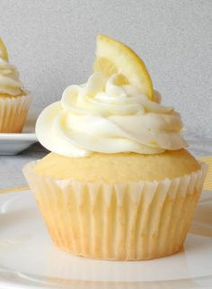 i'm makin these for the vid shoot sun.  Raspberry Filled Lemon Cupcakes