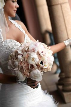 Sabrina carried a large bouquet composed of peonies, roses, and anemones in blush and ivory tones. #weddingbouquet Photography: Paul Barnett Photographer. Read More: http://www.insideweddings.com/weddings/pink-black-wedding-at-the-grand-del-mar-in-san-diego-california/379/