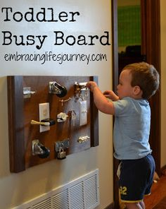 Toddler Busy Board. I like this idea EXCEPT the electrical outlet.  As a mom and a daycare provider (whos husband happens to be an electrican) I would say DONT do the outlet.  We dont need to help toddlers try to stick things in outlets