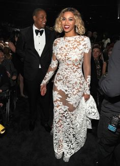 """See Beyoncé's Backstage Grammy Awards Fashion Through the Years Take a look at all of Beyoncé's Grammy fashion moments through the years! Beyonce wasspotted backstage with hubby Jay Z wearing a *gorgeous* white gown byMichael Costello. The couple performed """"Drunk In Love"""" together during the show."""