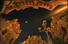 """""""Quattro canti"""", meaning """"Four Corners"""", once was the center of Palermo. Now it is thick with traffic. The facades of the houses are rounded - this is not distortion by a fisheye lens, just a rectilinear wideangle (15 mm)! Blue hour on the Piazza Duomo in the historic city of Siracusa, Sicily, Italy. Copyright by www.martin-liebermann.de - Commercial licensing: mailto:license@martin-liebermann.de Available as print from martin-liebermann.fineartamerica.com"""