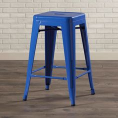 Pairing industrial style with contemporary appeal, this chic counter stool is crafted of metal and showcases a glossy finish.