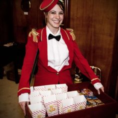 Usherette with flavoured complimentary Second Chance Cinema popcorn