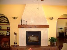 Do you enjoy your fireplace but don't like the finish?Do you just want to remodel your fireplace?Plastering, glazing and/or washing can totally transform a fireplace. Adobe Fireplace, Corner Gas Fireplace, Stucco Fireplace, Painted Brick Fireplaces, Brick Fireplace Makeover, Fireplace Built Ins, Fireplace Hearth, Fireplace Design, Fireplace Ideas
