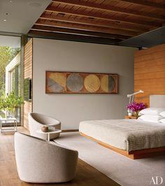 master bedroom of an Aspen home by architects Bohlin Cywinski Jackson and Shelton, Mindel & Associates, a photographic work by Edward Burtynsky overlooks the custom-made Douglas-fir bed