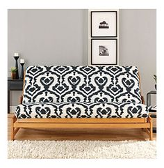 Use a duvet for a futon cover in a craft room that doubles as a