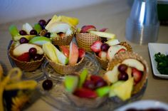 Curious George theme baby shower.  Fruit salad in waffle cone cups.