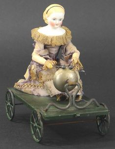 German Parian head doll with wooden arms, seated on painted green platform, arms outstretched and mallets in hand. When pulled along, the arms to move to ring the large bell mounted to front of cart. Old Dolls, Antique Dolls, Toy Wagon, Punch And Judy, Hobby Horse, Pull Toy, Living Dolls, Baby Carriage, American Soldiers