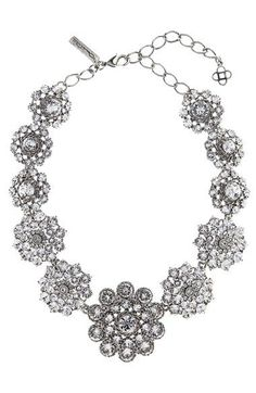 Free shipping and returns on Oscar de la Renta Swarovski Crystal Collar Necklace at Nordstrom.com. Designed with Oscar de la Renta's classic American glamour, this sculptural collar necklace is embellished with a mix of sparkling Swarovski crystals hand-set to resemble romantic floral blossoms.