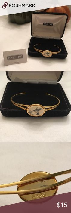 """Vintage Barlow Hummingbird cuff bracelet Collectible and Vintage gold tone bracelet features hummingbird and flowers on cream color stone (Scrimshaw Technique).  Backside has a couple small scratches.  Also signed """"Barlow"""" on back.  Very good vintage condition. Barlow Jewelry Bracelets"""