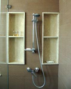 Add a tub tile shelf to the bathtub and shower enclosure to give your bathroom a customized look while making the area more functional and easier to clean. A tile shelf allows you to keep shampoo bottles and razors off the sides and corners of the bathtub, leading to a less-cluttered look. Tile shelves are best installed while you're tiling the rest of the tub and shower area. Whatever type of shelving you choose, make sure each shelf tilts slightly toward the drain so water does not pool…