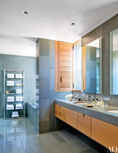 Matouk towels for Neiman Marcus are stowed on a circa-1960 nickel-and-glass étagère in the master bath of an Arizona residence created by architect Marwan Al-Sayed and decorator Jan Showers; the sink fittings are by Dornbracht.
