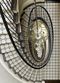 Interior decoration by SR Gambrel interior design firm based in New York. An oval staircase dressed with a geometric runner graces the entry of this New York City townhouse Architecture Details, Interior Architecture, Interior And Exterior, Interior Design, Staircase Architecture, Building Architecture, Amazing Architecture, Interior Ideas, Modern Interior